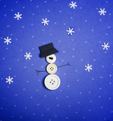 Snowman on blue background