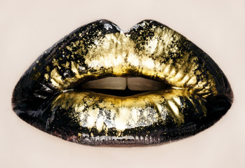 Black and gold lips close up, macro photography