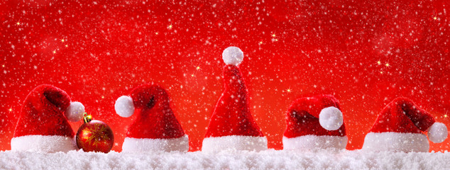 Christmas red background with Christmas hats.