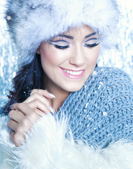 Woman covered with snow flakes. Christmas winter concept.