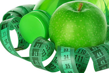 Fitness, weight loss concept with green apples
