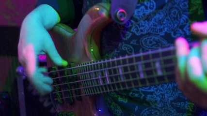 Fingers plays the bass guitar