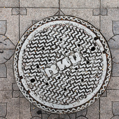 Close-up of the metal manhole cover in thailand