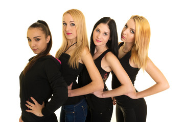 Quatre jeunes femmes heureuse isolé sur fond blanc