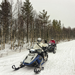Two girls on the snowmobiles