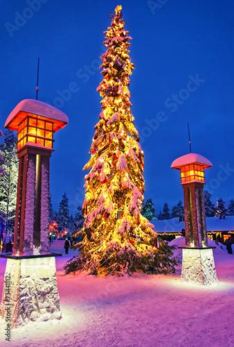 Leinwanddruck Bild Christmas tree in Santa Claus village at Arctic Circle near Rova