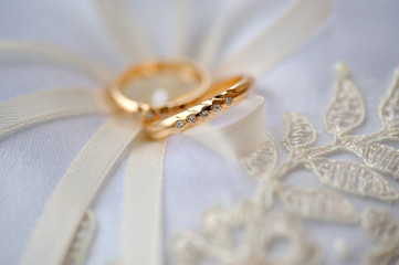 wedding two gold rings bride and groom