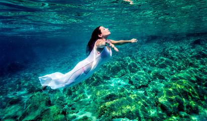 Beautiful woman relaxing in the water