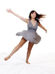 Young Asian American Woman Spinning In Dress