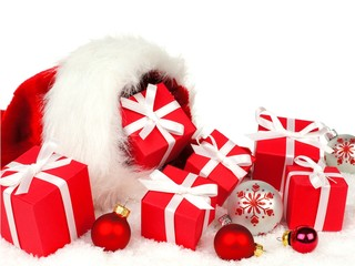Christmas gift boxes and baubles spilling from a Santa bag