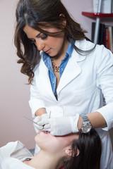 Examining patient's teeth