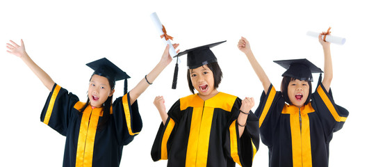 Group of excited asian school kids in graduation gown