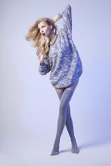 Fashionable blonde woman in studio