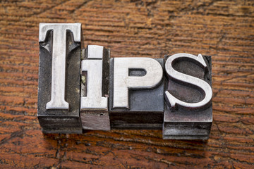 tips word in metal type