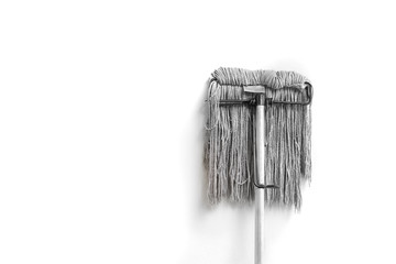 dirty mop isolated on white background