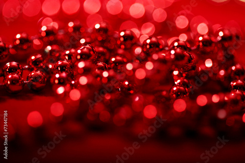 red beads with blurred lights bokeh for Christmas atmosphere