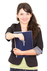 portrait of beautiful woman real estate agent holding a key