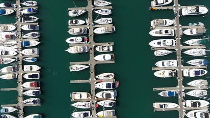 Aerial jib view shot of marina full of yachts