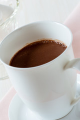 Cup of hot chocolate on a white table