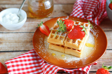 fresh waffles and strawberries with cream