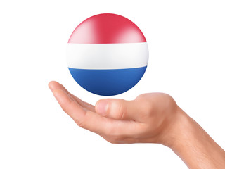 hand hold Netherlands flag icon on white bakground