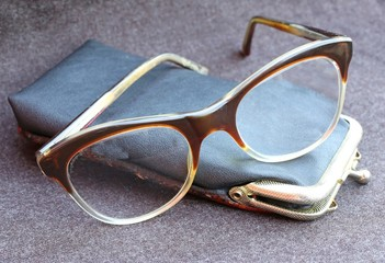old glasses of an old man with leather case