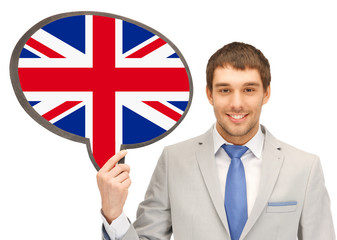 smiling man with text bubble of british flag