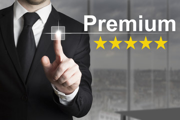 businessman pushing button premium golden rating stars