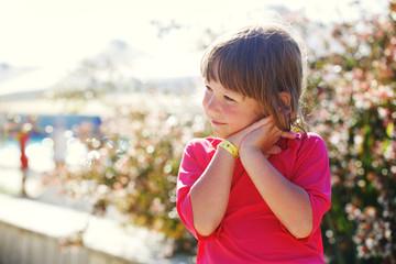 Little girl on vacation enjoys sun.