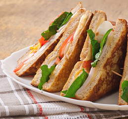 Club sandwich with chicken and ham