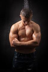 Muscular man under the shower