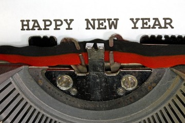 Happy new year written with black ink with the typewriter