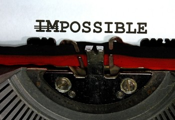 impossible but possible  written with black ink