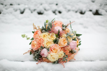 Wedding flowers closeup. Bridal bouquet in the snow.