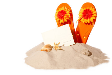 Beach concept with postcard and flip-flops