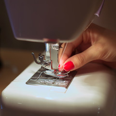 Sewing Process - Women's hands behind her sewing