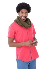 Smiling man standing and text messaging