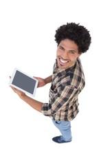 Happy man holding digital tablet