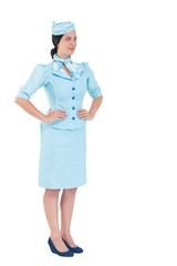 Pretty air hostess with hands on hips
