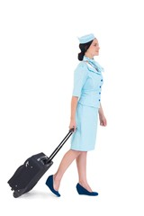 Pretty air hostess walking with suitcase