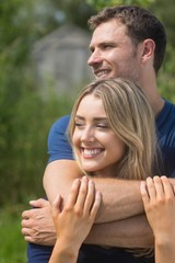 Cute couple smiling and hugging