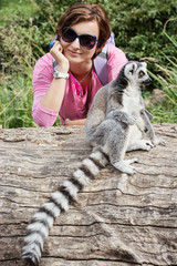Ring-tailed lemur and young caucasian woman