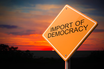 Import of Democracy on Warning Road Sign.