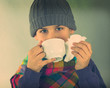 ill boy drinking some tea