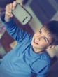 boy taking selfie with smart phone