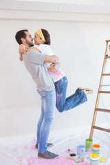 Cute couple hugging while redecorating
