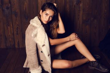 beautiful girl with dark hair wearing elegant fur coat