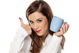 Fototapety beautiful young woman holding a cup of tea and showing thumbs up