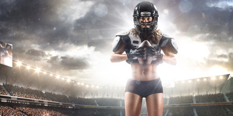 American football female player is posing