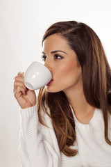 Beautiful young woman enjoying a morning coffee